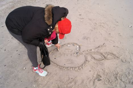 Graffiti artist decorating the beach