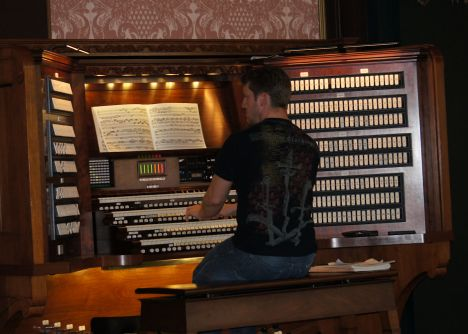 An organist is employed to keep the flowers happy!